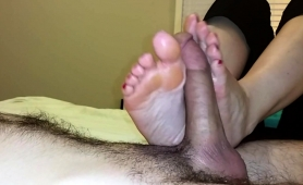 lucky-guy-has-a-pair-of-sensual-feet-caressing-his-meat-pole
