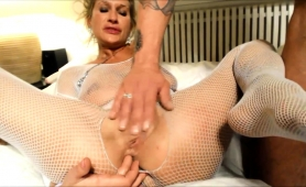 stacked-blonde-cougar-in-fishnets-gets-her-holes-fingered