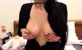 bodacious-brunette-camgirl-sensually-caresses-her-nipples