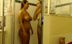 two-lustful-lesbian-friends-kiss-each-other-in-the-shower