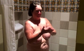 chubby-brunette-granny-flaunts-her-sexy-body-in-the-shower