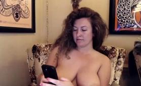 big-breasted-amateur-milf-showing-off-her-curves-on-webcam
