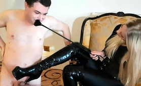 blonde-mistress-in-a-black-outfit-punishes-a-naughty-slave