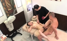 gorgeous-japanese-babe-enjoys-two-cocks-on-the-massage-bed