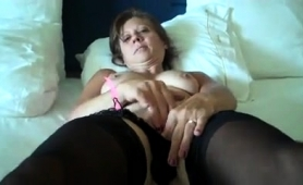 Busty Mature Brunette In Stockings Caresses Her Aching Pussy