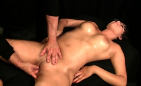 buxom-brunette-milf-is-made-to-cum-hard-on-the-massage-bed
