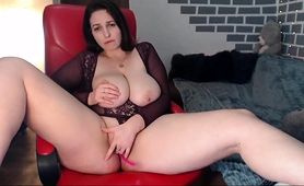 big-breasted-brunette-milf-pleases-her-aching-cunt-on-webcam