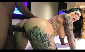 buxom-tattooed-brunette-gets-banged-doggystyle-and-creampied