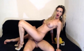 sexy-blonde-milf-with-big-boobs-fucks-a-cock-on-the-webcam